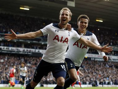 Tottenham Hotspur's Harry Kane, front, celebrates after scoring against Arsenal. AP