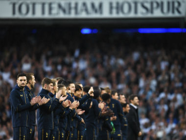Tottenham Hotspur players look on during the closing ceremony after their match against Premier League. Getty Images