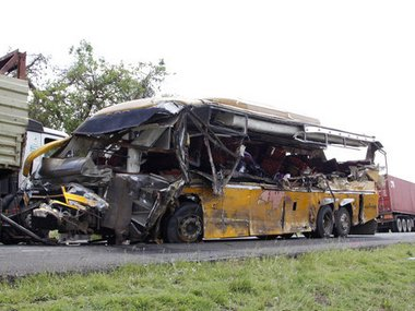 The wreckage of a Buscar Bus Company vehicle that was involved in a road accident in the Kambuu area of Makueni, along the Nairobi-Mombasa highway, in Makindu, Kenya, Tuesday, April 25. 2017. Kenyan police say over 25 people have been killed in a collision between a bus and a trailer truck. Police say the accident took place along the major road linking two of Kenya's biggest cities, capital Nairobi and the port of Mombasa. (AP Photo/Khalil Senosi)