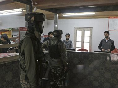 A file photo of security personnel investigating a bank robbery in Pulwama district of south Kashmir on Wednesday. PTI