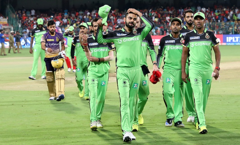 Royal Challengers Bangalore team, in their green jerseys, after losing to KKR. Sunil Narine scored a fifty in the game. Sportzpics