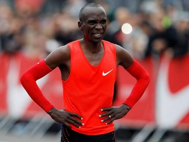 Kenyan Eliud Kipchoge reacts after crossing the finish line during an attempt to breake the two-hour marathon barrier at the Monza circuit in Italy, May 6, 2017. REUTERS/Alessandro Garofalo