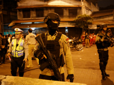 Police guard at scene of an explosion in Jakarta. Reuters