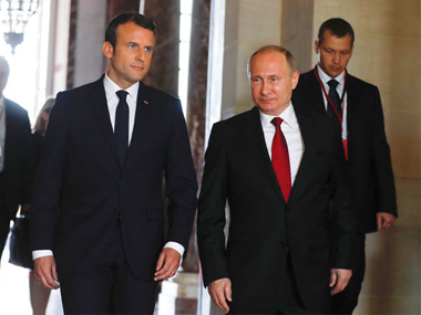French president Emmanuel Macron with his Russian counterpart Vladimir Putin in France on Monday. AP