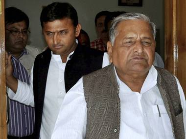 Mulayam Singh Yadav with his son Akhilesh Yadav. PTI