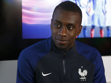 France's midfielder Blaise Matuidi holds a press conference to present the new French national football team jersey, on March 17 in Paris, ahead of the Euro 2016 European football championships. / AFP PHOTO / THOMAS SAMSON