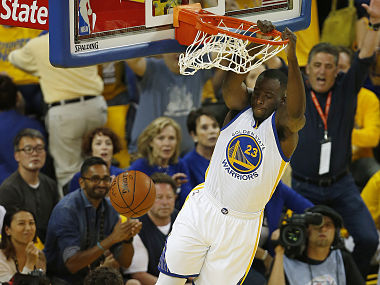 Golden State Warriors forward Draymond Green dunks the ball during the first quarter in Game 7 of the NBA Finals on June 19, 2016 in Oakland, California. / AFP PHOTO / Beck Diefenbach