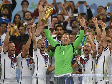 Germany's goalkeeper Manuel Neuer (front C) and team-mates celebrate with the World Cup trophy after they won the 2014 FIFA World Cup final football match between Germany and Argentina 1-0 following extra-time at the Maracana Stadium in Rio de Janeiro, Brazil, on July 13, 2014. AFP PHOTO / FABRICE COFFRINI / AFP PHOTO / FABRICE COFFRINI