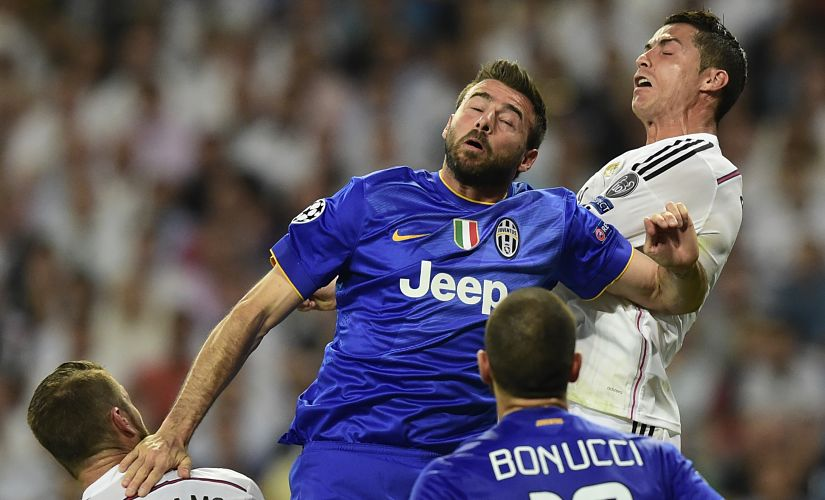 Real Madrid's defender Sergio Ramos (L) and Real Madrid's Portuguese forward Cristiano Ronaldo vie with Juventus' defender Andrea Barzagli (L), Juventus' defender Leonardo Bonucci during the UEFA Champions League semi-final second leg football match Real Madrid FC vs Juventus at the Santiago Bernabeu stadium in Madrid on May 13, 2015. AFP PHOTO/ JAVIER SORIANO / AFP PHOTO / JAVIER SORIANO
