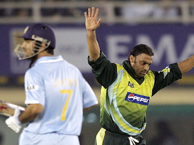 File Image of Pakistani fast bowler Shoaib Akhtar (R) reacting after taking the wicket of then Indian captain Mahendra Singh Dhoni (L) . AFP