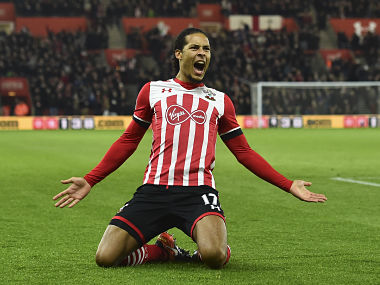 Southampton's Dutch defender Virgil van Dijk celebrates scoring the opening goal during the English Premier League football match between Southampton and Tottenham Hotspur at St Mary's Stadium in Southampton, southern England on December 28, 2016. / AFP PHOTO / Glyn KIRK / RESTRICTED TO EDITORIAL USE. No use with unauthorized audio, video, data, fixture lists, club/league logos or 'live' services. Online in-match use limited to 75 images, no video emulation. No use in betting, games or single club/league/player publications. /