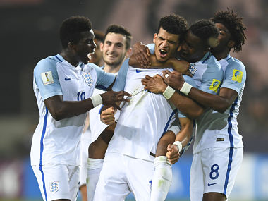 England's forward Dominic Solanke (#10) celebrates his goal with teammates during the U-20 World Cup semi-final football match between England and Italy in Jeonju on June 8, 2017. / AFP PHOTO / JUNG Yeon-Je