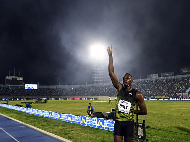 """Usain Bolt of Jamaica salutes the crowd after winning 100m """"Salute to a Legend """" race. AFP"""