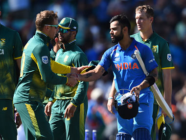 India's captain Virat Kohli (2nd R) shakes hands with South Africa's David Miller after the ICC Champions Trophy match between South Africa and India. AFP