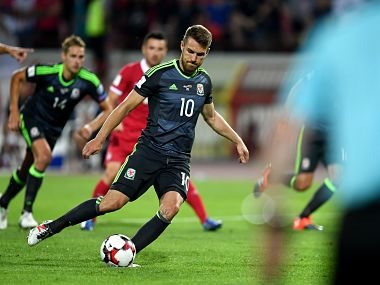 Wales' midfielder Aaron Ramsey takes a penalty kick during the WC 2018 football qualification match between Serbia and Wales in Belgrade on June 11, 2017. / AFP PHOTO / ANDREJ ISAKOVIC