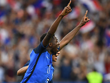 France's forward Ousmane Dembele (L) celebrates after scoring AFP
