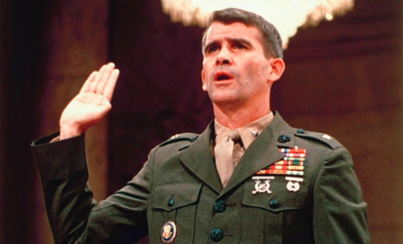 Lieutenant Colonel Oliver North is sworn in before the Iran Contra Committee prior to his testimony in Washington. AP