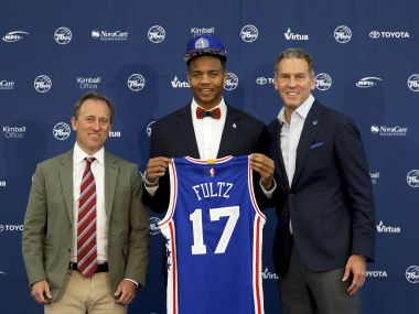 Philadelphia 76ers' draft pick Markelle Fultz, center, poses with team president and managing owner. AP