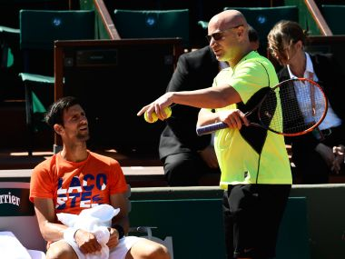 Novak Djokovic (L) with Andre Agassi during a training session. AFP