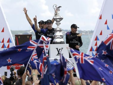 New Zealand helmsman Peter Burling and Glenn Ashby, right, celebrate with teammates after winning America's Cup. AP
