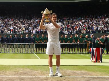LONDON, ENGLAND - JULY 10: Andy Murray of Great Britain lifts the trophy following victory in the Men's Singles Final against Milos Raonic of Canada on day thirteen of the Wimbledon Lawn Tennis Championships at the All England Lawn Tennis and Croquet Club on July 10, 2016 in London, England. (Photo by Julian Finney/Getty Images)