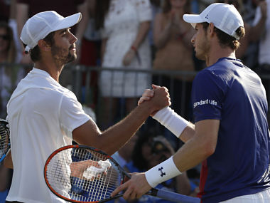 Andy Murray congratulates Australia's Jordan Thompson after losing to him at Queen's Club tennis tournament. AP