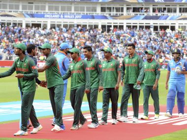 India and Bangladesh players shake hands at the end of their Champions Trophy semi-final match. AP