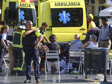 Injured people being treated in Barcelona on Friday. AP