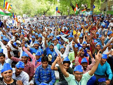 Bhim Sena supporters holding a protest over the arrest of their leaders at Jantar Mantar in New Delhi on Sunday. PTI