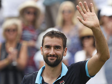 Marin Cilic of Croatia celebrates the winning match point against Stefan Kozlov of the United States during day four of the Queen's Club tennis tournament in London, Thursday, June 22, 2017. (AP Photo/Kirsty Wigglesworth)