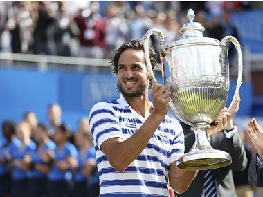 Spain's Feliciano Lopez celebrates with the trophy after winning the final against Croatia's Marin Cilic. AP