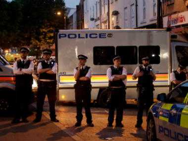 British police stands guard near the Finsbury Park mosque early Monday morning. AP