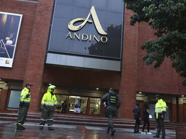 A member of the bomb squad rushes to the Centro Andino shopping mall in Colombia. AP