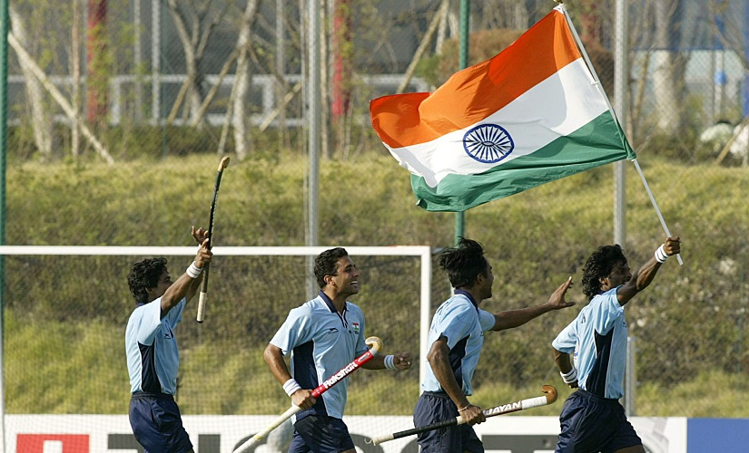 Dhanraj Pillay carries India's flag after their win over Pakistan in the semi-final of the 14th Asian Games in 2002. REUTERS