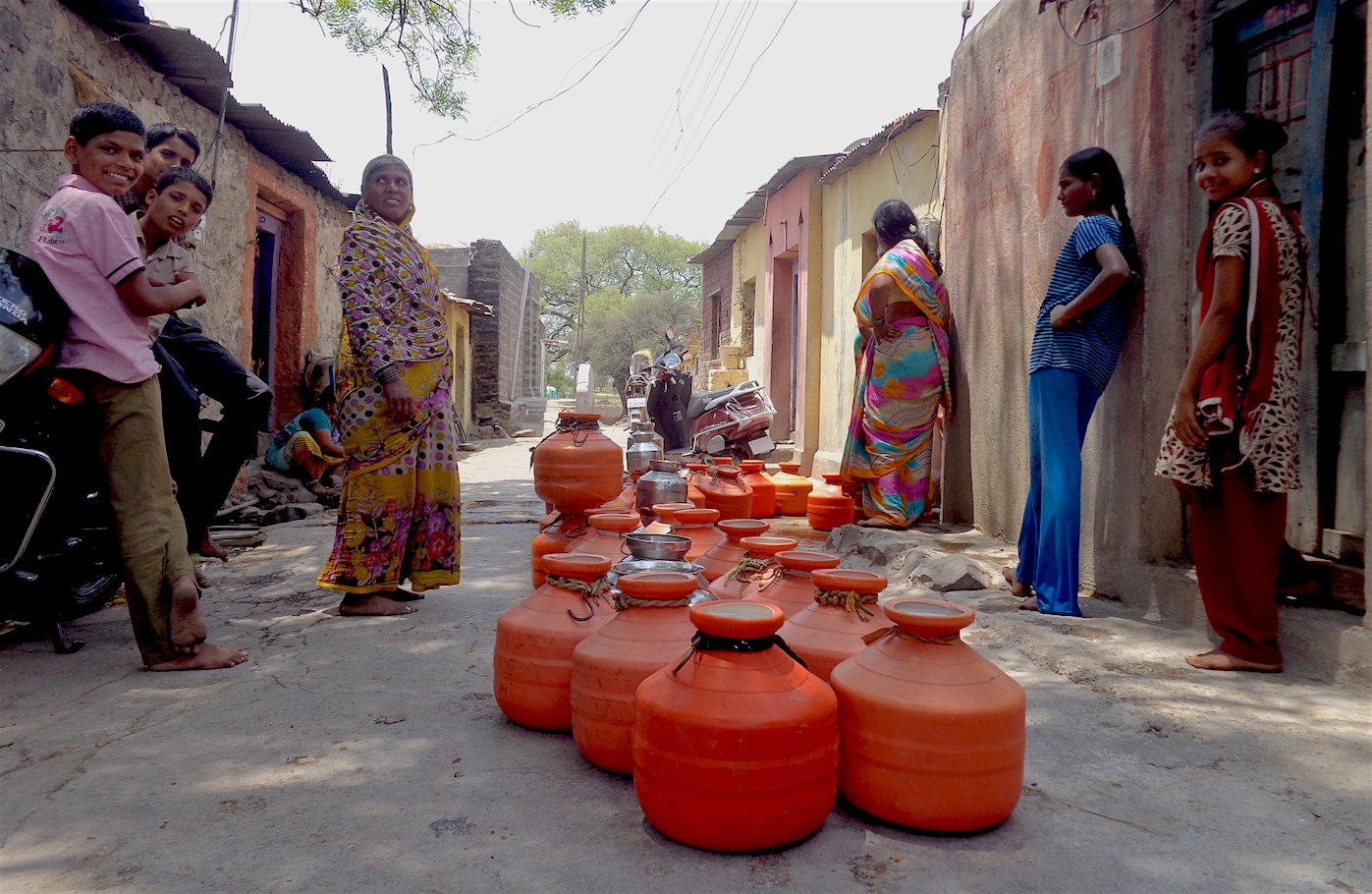 A line of orange pots outside the house of a local teacher who opens up his private borewell to the public a few times each week in Takwiki village. Parth MN