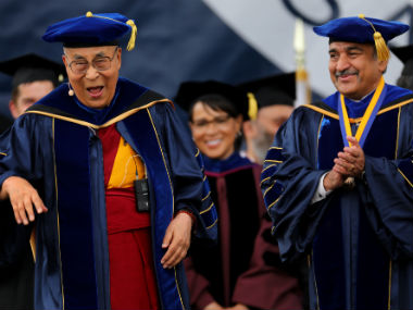 The 14th Dalai Lama shares a laugh with Pradeep K Khosla, UC San Diego Chancellor. Reuters