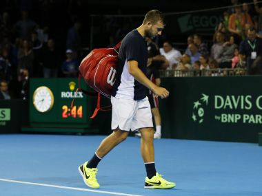 Tennis Britain - Great Britain v Argentina - Davis Cup Semi Final - Emirates Arena, Glasgow, Scotland - 18/9/16 Britain's Dan Evans looks dejected at the end of the match Action Images via Reuters / Andrew Boyers Livepic EDITORIAL USE ONLY. - RTSOB53