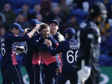 England's Mark Wood (centre) celebrates the wicket of New Zealand's Kane Williamson with teammates. Reuters