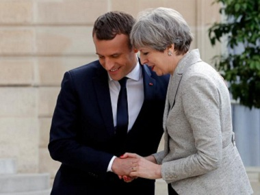 French President Emmanuel Macron with British Prime Minister Theresa May. Reuters