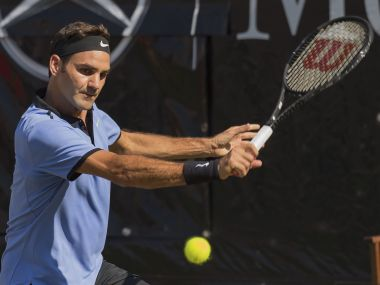 Roger Federer of Switzerland returns the ball to Germany's Tommy Haas during their match at the Mercedes Cup tennis tournament in Stuttgart, Germany, Wednesday, June 14, 2017. (Daniel Maurer/dpa via AP)