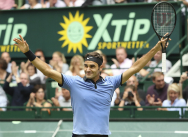 Roger Federer celebrates his victory in the final match against Germany's Alexander Zverev at Halle Open. AP