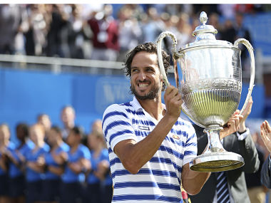 Spain's Feliciano Lopez with the trophy after winning Queen's Club tournament. AP