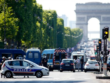 Police forces secure the area on the Champs Elysées in Paris on Monday. AP