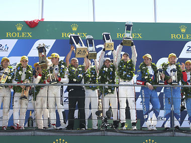Members of the Porsche Team on  podium of the 85th 24-hour Le Mans endurance race, . AP