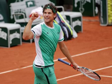 Dominic Thiem clenches his fist after defeating Novak Djokovic during their quarter-final match. AP