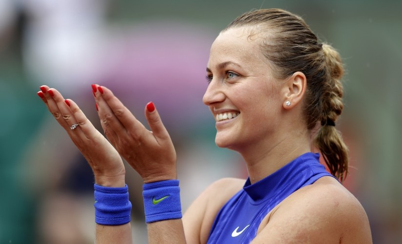 Petra Kvitova thanks the crowd after defeating Julia Boserup in their first round match of the French Open. AP