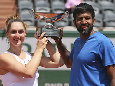 Canada's Gabriela Dabrowski and India's Rohan Bopanna hold the trophy as they celebrate winning their mixed doubles final match against Anna-Lena Groenefeld of Germany and Robert Farah of Colombia in two sets 2-6, 6-2 (12-10), of the French Open tennis tournament at the Roland Garros stadium, in Paris, France, Thursday, June 8, 2017. (AP Photo/David Vincent)