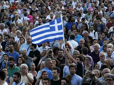 A rally outside parliament in Athens in June called for the Greek government to agree a deal with its creditors. Reuters