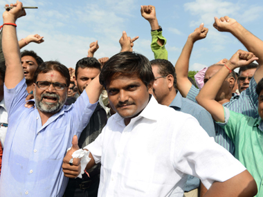 File image of Hardik Patel (C). AFP