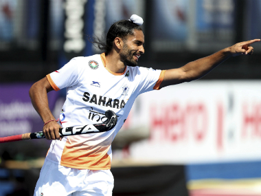 Akashdeep Singh celebrates after scoring India's third goal against Scotland. AP